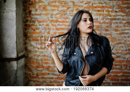 Brunette Plus Size Sexy Woman, Wear At Black Leather Jacket, Lace Panties Near Brick Wall At Abadone