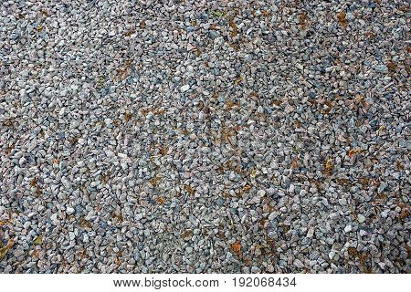 Gray background of small stones of building crushed stone