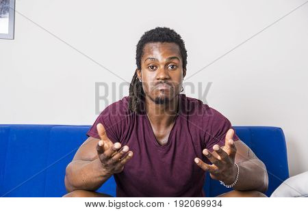 Handsome unsure, doubtful black man thinking, looking up with dubious expression on his face