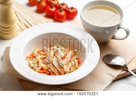 Close up of classic chicken noodle soup