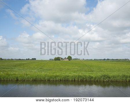 farm in green grassy countryside near european cultural capital 2018 Leeuwarden in Friesland