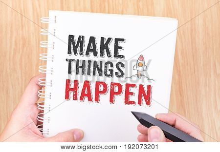 Make Things Happen Word On White Ring Binder Notebook With Hand Holding Pencil On Wood Table,busines