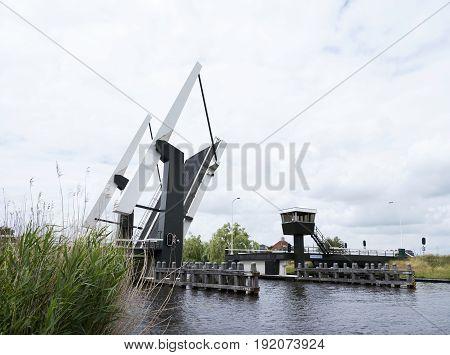 open modern drawbridge near Sneek in dutch province of friesland on overcast day in early summer