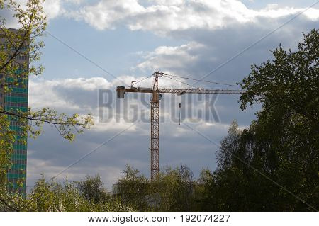 High-rise crane used in the construction of a multi-storey building