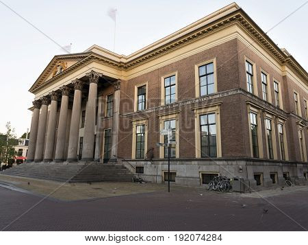 neo classical old courthouse in leeuwarden capital of the dutch province of Friesland in warm morning light