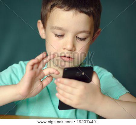 Happy cute  boy using tablet, indoor shoot