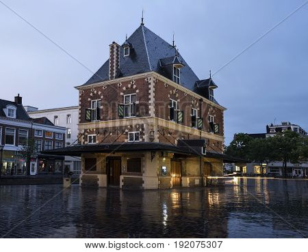 building Waag at dusk in the center of old city leeuwarden - cultural capital of Europe in 2018 - in friesland which is a province of the netherlands