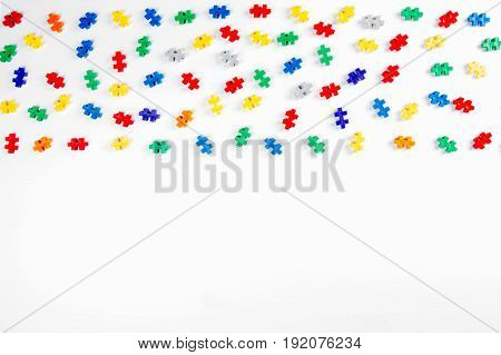Colorful constructor details frame on white background. Top view