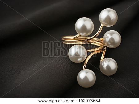 jewelry ring with pearl on black cloth