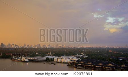 Beautiful lightnings and rainbow in the evening after heavy raining Bangkok Thailand