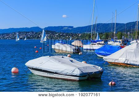 Zurich, Switzerland - 18 June, 2017: boats on Lake Zurich, view from the city of Zurich. Lake Zurich is a lake in Switzerland extending southeast of the city of Zurich, which is the largest city in Switzerland.