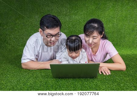 Asian Chinese Parents And Daughter Playing Laptop