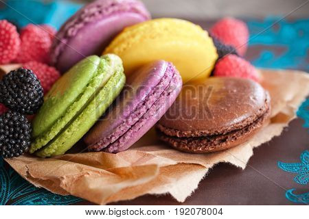 Colorful delicious macaroons background paper fresh detail