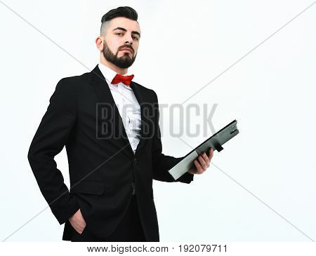 Manager In Black Suit And Red Bow Holds Clip Folder