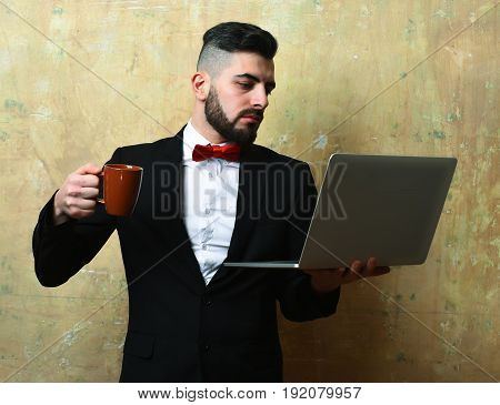 Business Worker With Busy Thinking Face Holds Cup And Laptop