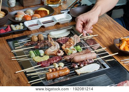 Various Skewer Foods, Men's Hands