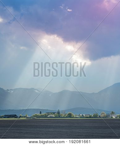 Sun beams over the mountain range landscape