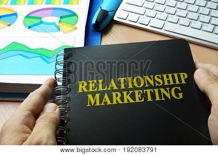 Documents with title relationship marketing on a table.