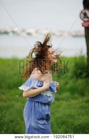 Portrait Of A Fantastic Young Girl Having Fun In The Park Next To The Lake.