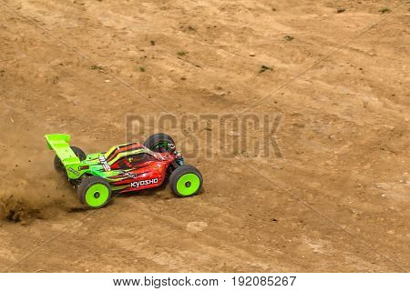 2016/06/18 Melitopol. Ukraine. Competitions Between Buggy Models. Radio Controlled Car Model In Race