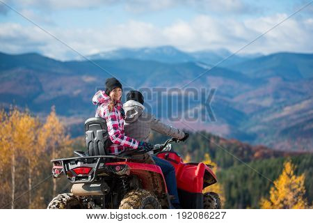 Guy Driving Atv, Girl Sitting Behind Him And Turned Around, Looking At The Camera And Smiling. Beaut