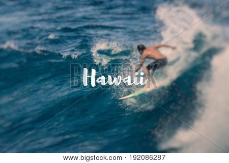 Hawaii. Extreme surfer riding giant ocean wave.