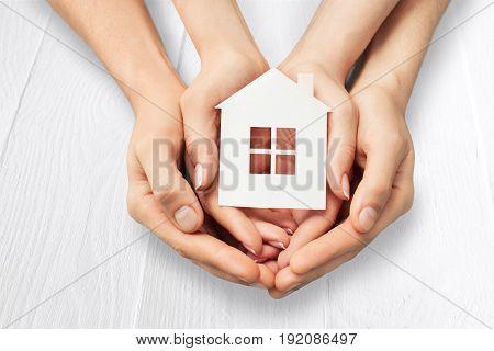 Holding model hands house house model close up real estate