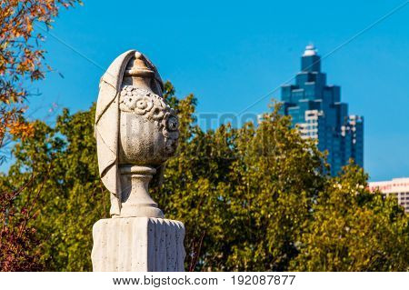Atlanta, Georgia, USA - December 22, 2016: The gypseous sculpture of funeral urn on the Oakland Cemetery in sunny autumn day