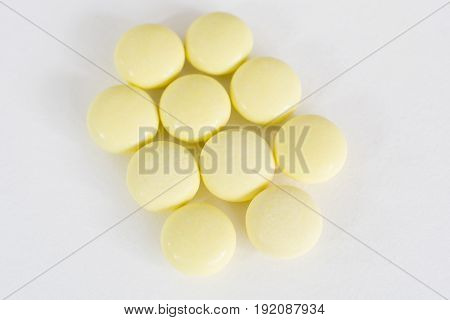 Pharmacy Theme, Yellow Medicine Tablets Isolated On White Background