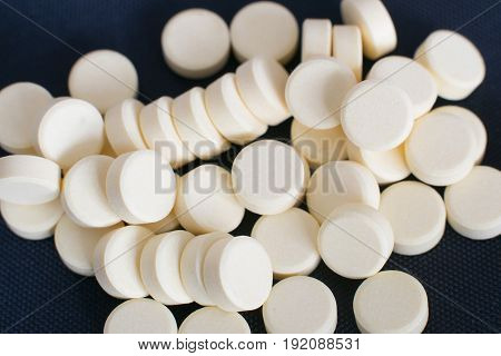 Pharmacy Theme, White Medicine Tablets Isolated On Black Background