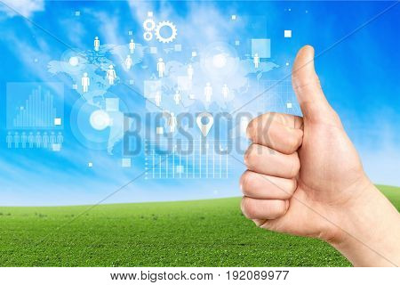 Male hand thumb showing thumbs up hand sign close-up