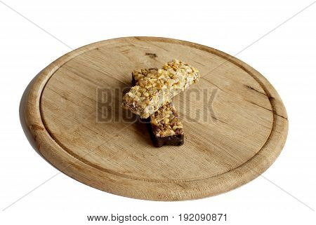 Muesli snack on a wooden board in the white background