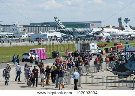 BERLIN GERMANY - JUNE 03 2016: Visitors and guests of the exhibition at the airfield. Exhibition ILA Berlin Air Show 2016