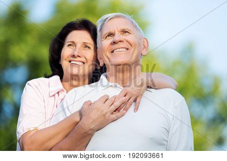 Park couple elderly hugging two people senior adult heterosexual couple
