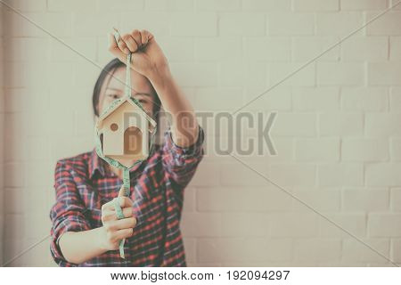 young beautiful woman saving money for the house, selective focus, vintage