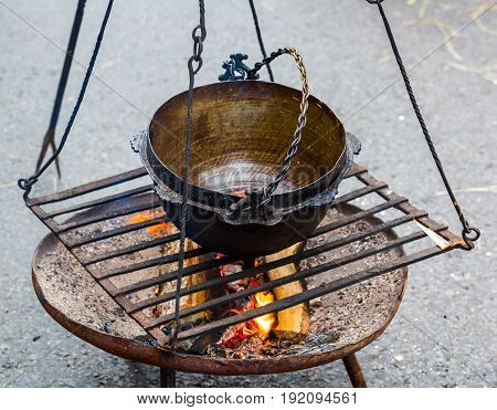 Cooking in old cast-iron on tripod outside