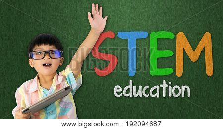 boy holding tablet raise his hand up for STEM education