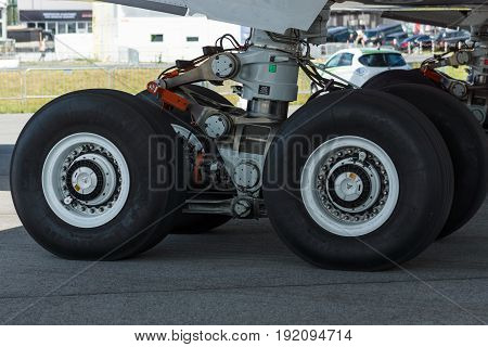 BERLIN GERMANY - JUNE 03 2016: Landing gear of the newest airplane Airbus A350-900 XWB. Exhibition ILA Berlin Air Show 2016