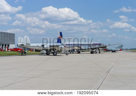 BERLIN GERMANY - JUNE 03 2016: A piston-powered airliner and transport aircraft Douglas DC-6 and American twin-engine medium bomber North American B-25J Mitchell. The Flying Bulls Team. Exhibition ILA Berlin Air Show 2016