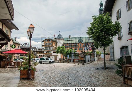 Megève, France - June 25, 2016. View of street in the city center, with car and shops. Megève is a famous ski resort located in Haute-Savoie Province, near the Mont Blanc in the French Alps