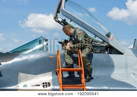 BERLIN GERMANY - JUNE 03 2016: The pilot and the visitor near the cockpit of the multirole fighter Mikojan-Gurewitsch MiG-29. Polish Air Force. Exhibition ILA Berlin Air Show 2016