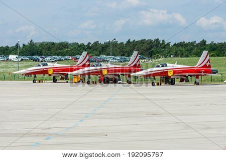 BERLIN GERMANY - JUNE 03 2016: Aircrafts Northrop F-5E Tiger II of the aerobatic team of the Swiss Patrouille Suisse. Exhibition ILA Berlin Air Show 2016