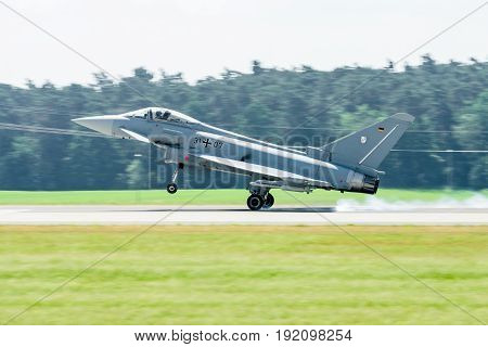 BERLIN GERMANY - JUNE 03 2016: Landing multirole fighter Eurofighter Typhoon. Exhibition ILA Berlin Air Show 2016