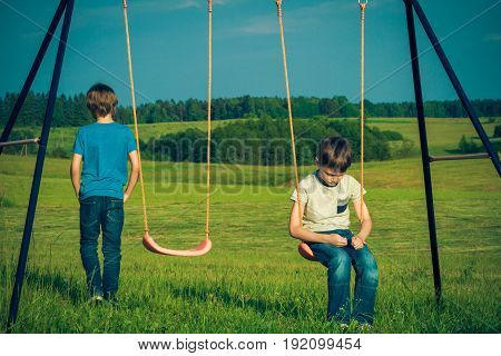 Kids relationship difficulties. Child falls out with a friend outdoors