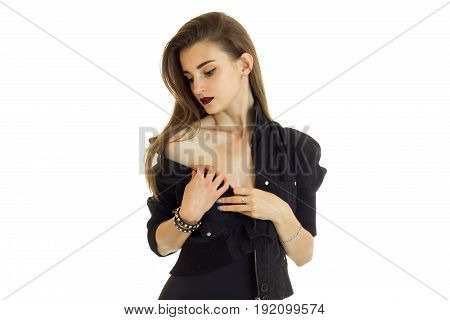 Young woman in black jacket without bra looking down isolated on white background