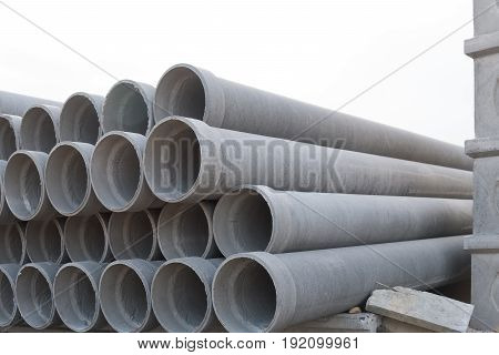 Asbestos cement pipes used for drainage construction. Isolated on white background.