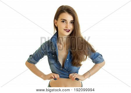 Cutie young girl in jeans t-shirt without bra bite a lips isolated on white background