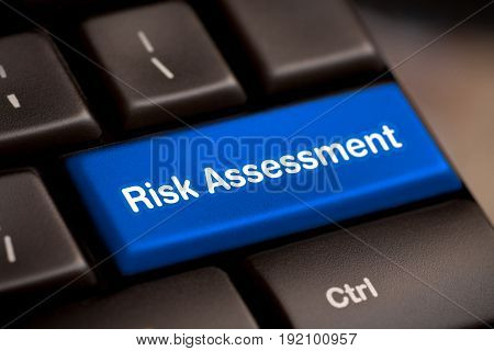 Computer keyboard with key for risk assessment.