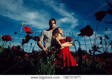 Love And Romance Of Couple In Red Poppy Field