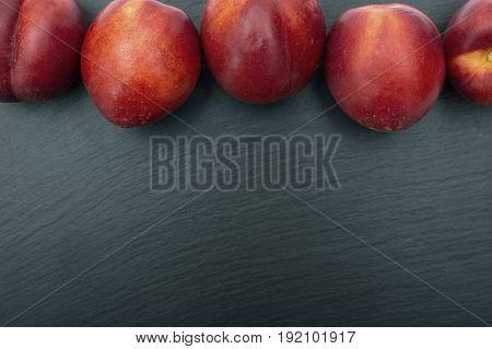 Ripe Nectarine On Black Background Of Slate Or Stone